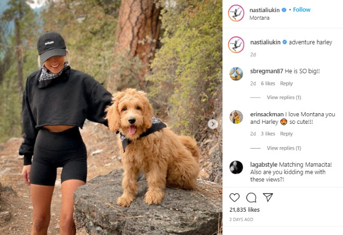 Nastia poses with her dog
