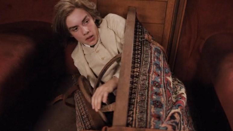 Louis Partridge on the set of Enola Holmes
