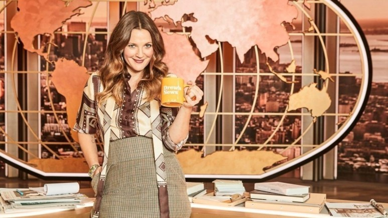 Drew Barrymore at the desk of her new talk show