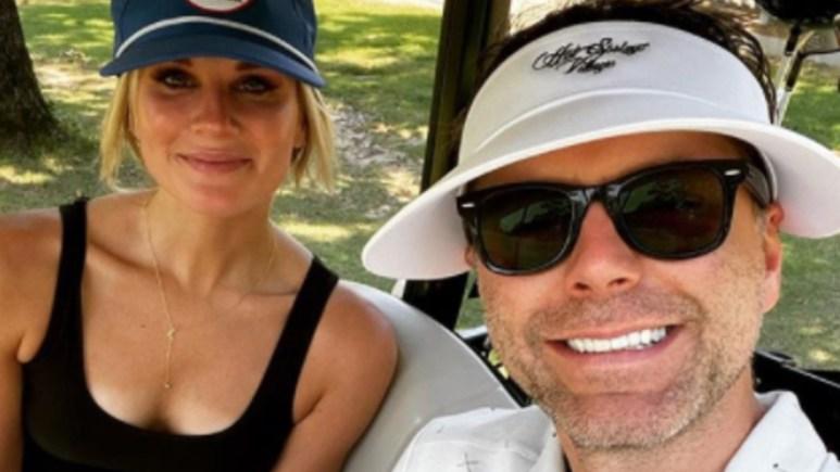 Bobby Bones and Caitlin Parker pose for a selfie on Instagram
