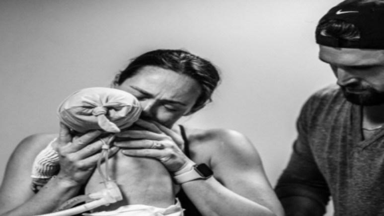 Kara Bosworth kissing newborn son