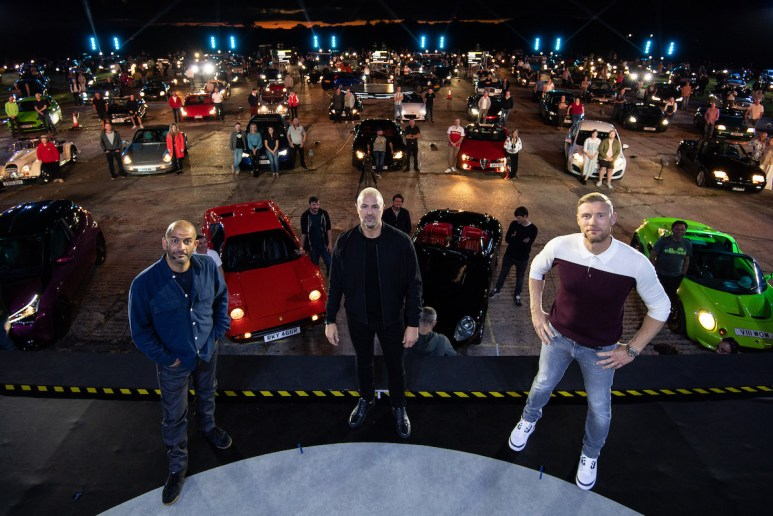 Chris Harris, Freddie Flintoff and Paddy McGuinness on stage in front of Top Gear fans and their vehicles
