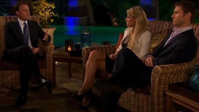 Jake Pavelka and Vienna Girardi sit outside with Chris Harrison by a pool at night