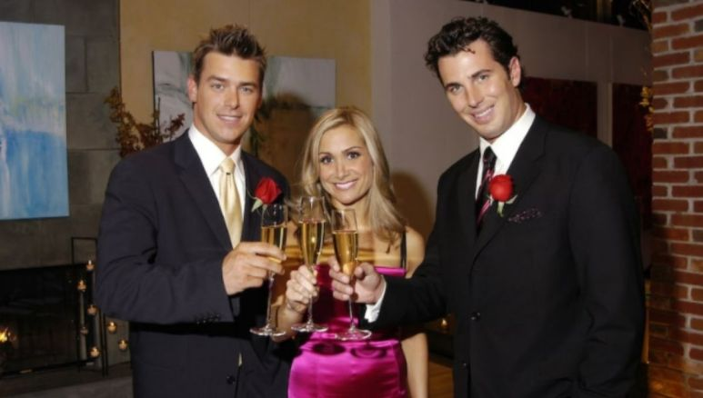Jen Schefft poses with her final two men as they toast with champagne