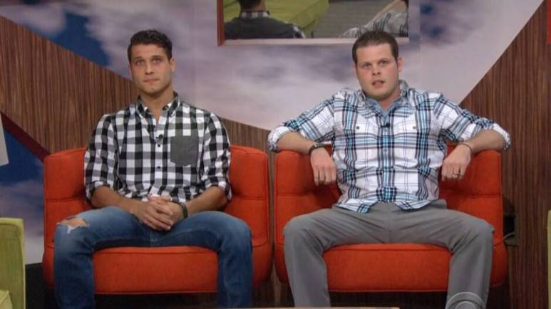 Cody Calfiore and Derrick Levasseur sit in big red chairs.