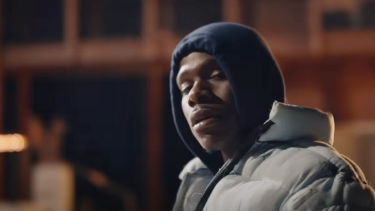 DaBaby performs in a music video