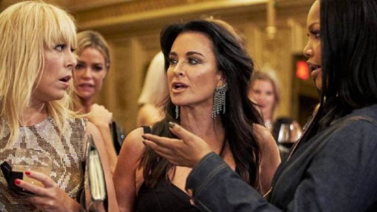 Kyle Richards, Garcelle Beauvais and Sutton Starcke talk while filming RHOBH.