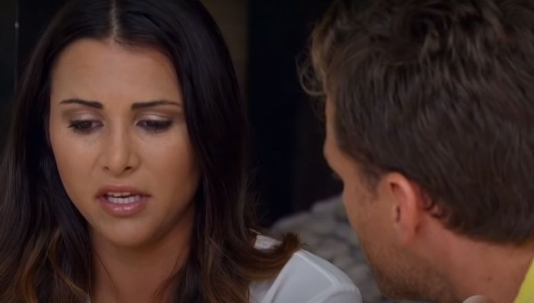 Andi Dorfamn looking serious as she speaks to Juan Pablo