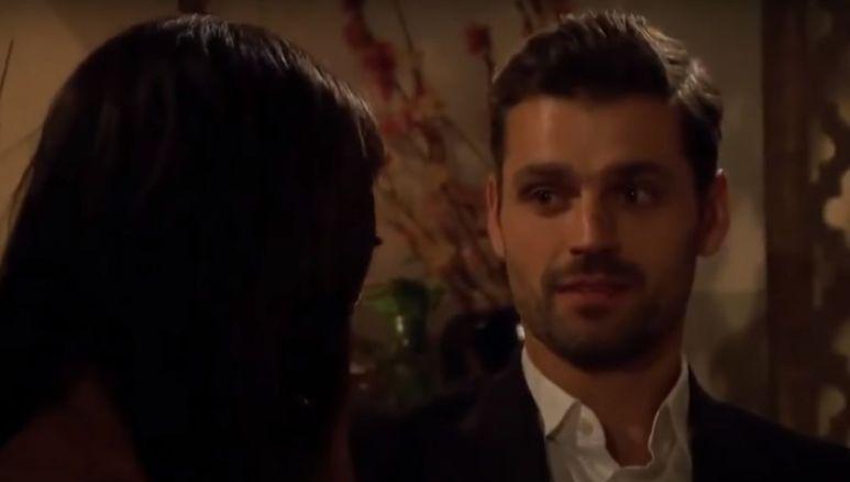 Peter Kraus in a suit looking at Rachel Lindsay
