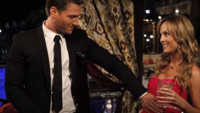 Juan Pablo Galavis in a suit touching Clare Crawley's pregnant belly