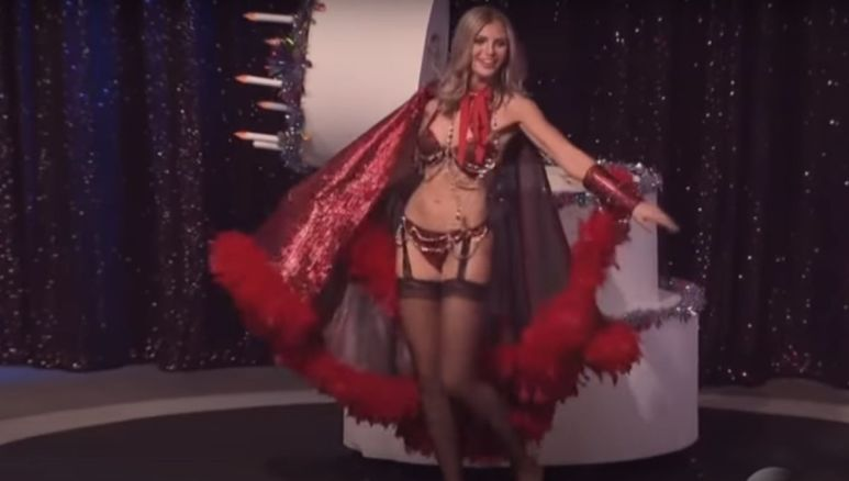 Olivia Caridi in a red sparkly costume on stage