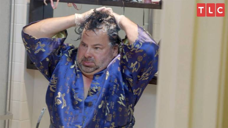 Big Ed puts mayonnaise in his hair as he films for 90 Day Fiance.