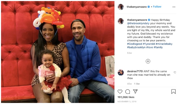 RHOA star Kenya Moore and Marc Daly with their daughter, Brooklyn.