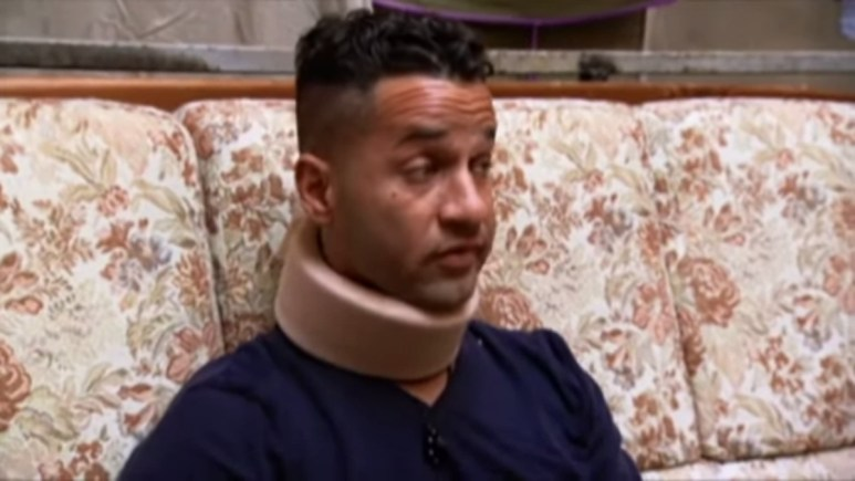 Mike had to wear a neckbrace after he head butted a brick wall. Pic credit: MTV
