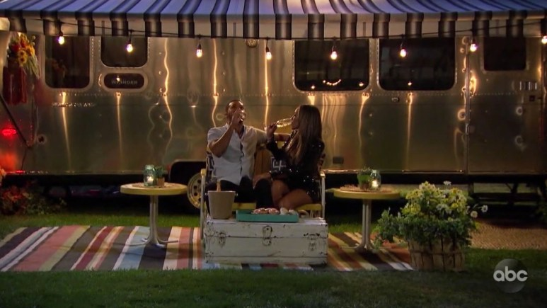 The Bachelorette Tayshia Adams and Ivan sitting outside a trailer for fantasy suite