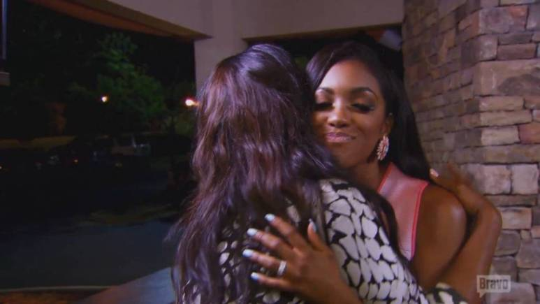 Porsha hugs it out with her costar Kenya Moore after their nasty brawl the season before.