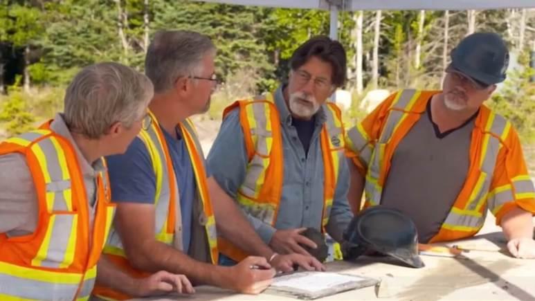 Oak Island team discuss the Money Pit on set