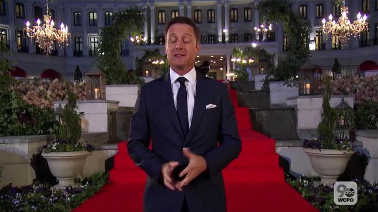 The Bachelor host Chris Harrison standing in front of large chateau