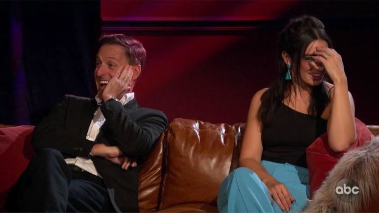 The Bachelor host Chris Harrison looking surprised while Ashley I cringes