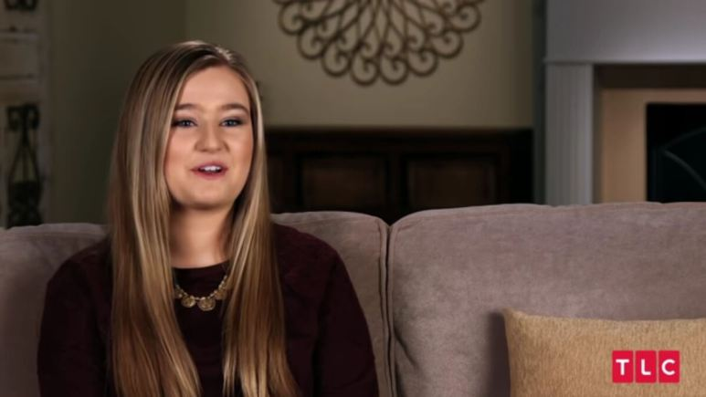 Kendra Caldwell in a Counting On confessional.