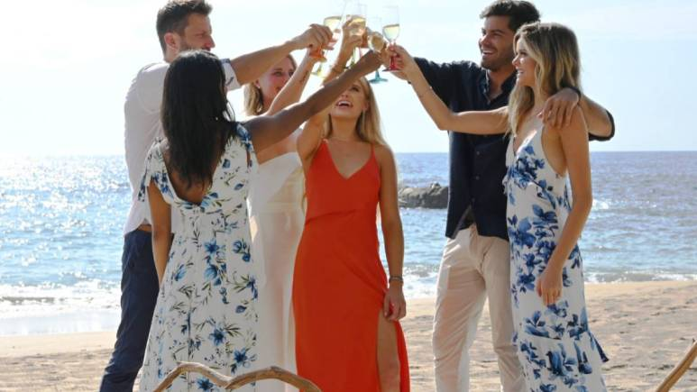 Bachelor in Paradise contestants clink glasses