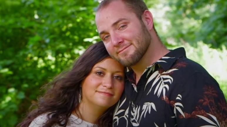 Sabrina Burkholder poses with boyfriend Jethro in a screen grab.