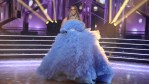 Tyra Banks wears a flowing blue dress during the DWTS Season 19 finale.