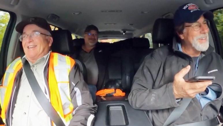 Oak Island team members in a car