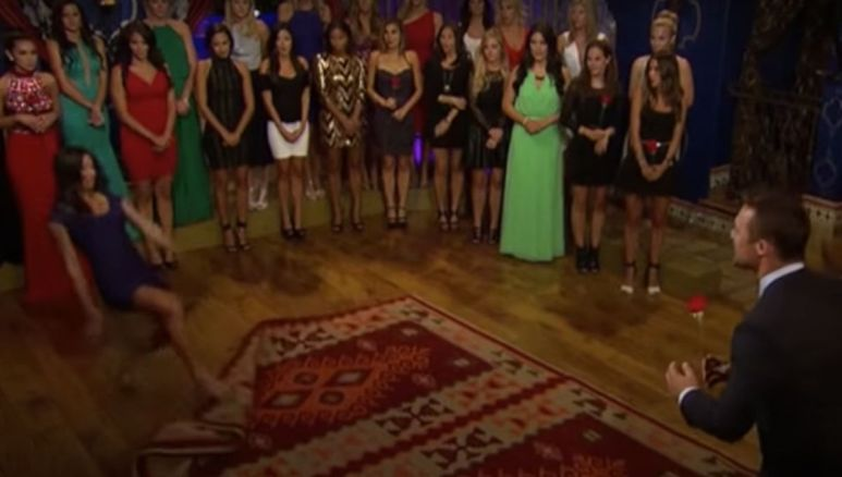 Contestants stand in front of Chris Soules during the rose ceremony