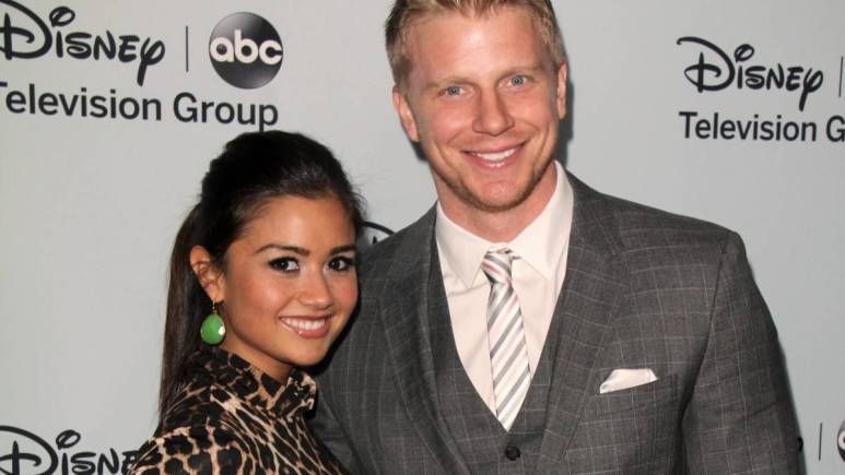 Sean Lowe and Catherine Giudici pose on the red carpet