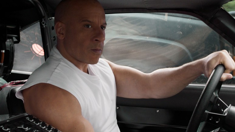 Vin Diesel driving a car in Fast and Furious 9.