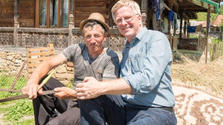 Rick hitches a cart ride with a farmer in Maramureș, Romania