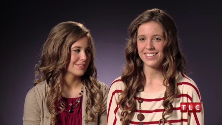 Jana and Jill Duggar in a 19 Kids and Counting confessional.