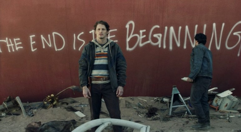 Characters spraypaint the USS Pennsylvania in Episode 1 of AMC's Fear the Walking Dead Season 6