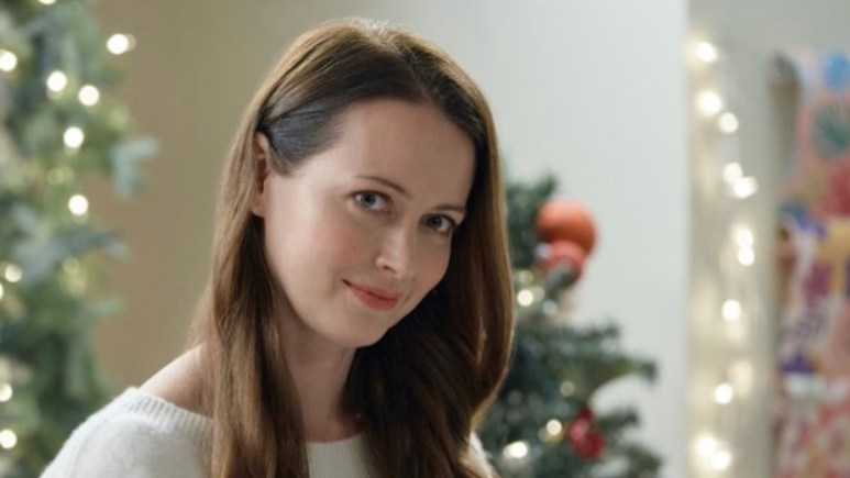 Amy Acker stars in Crashing Through the Snow, an original movie premiering during Hallmark Channel's annual Christmas in July event.