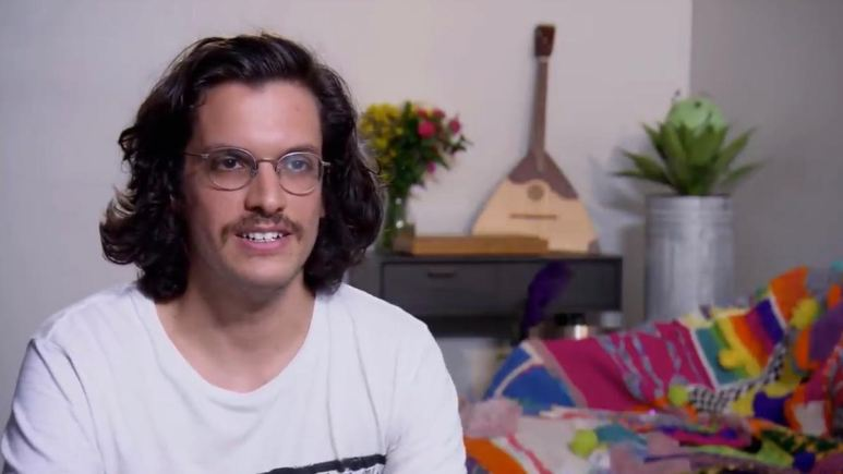 Bennett Kirschner wears glasses and looks directly in the camera