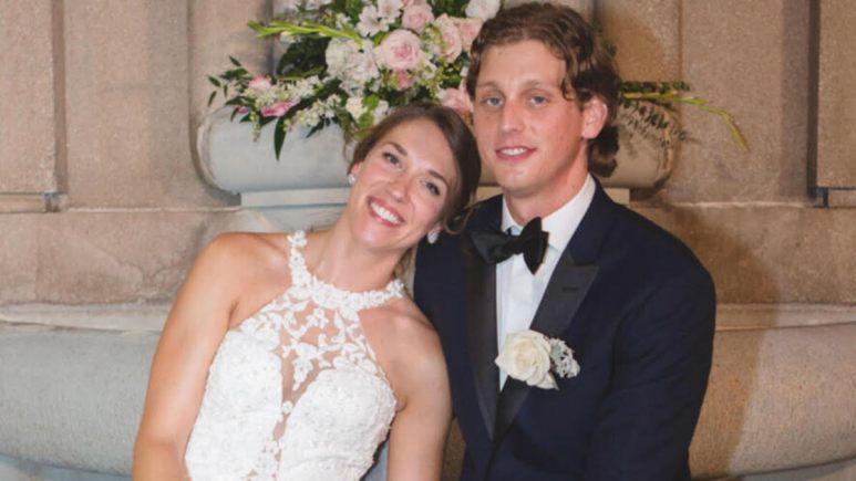 Jessica Studer wears a wedding dress and rests her head on Austin Hurd's shoulder
