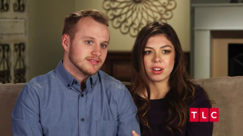 Josiah Duggar and Lauren Swanson in a Counting On confessional.