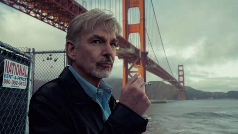 Billy Bob Thornton standing in front of the Golden Gate Bridge