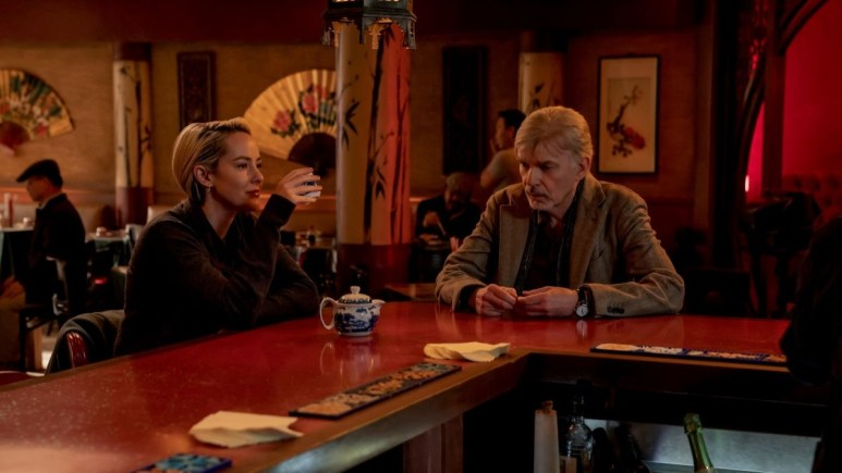 Billy Bob Thornton and Jena Malone sitting in a bar on the set of Goliath