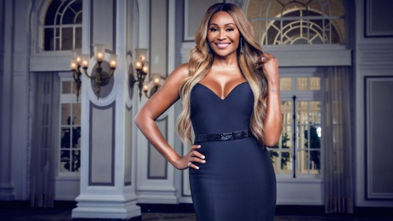 The Real Housewives of Atlanta star Cynthia Bailey puts her hand on her hip