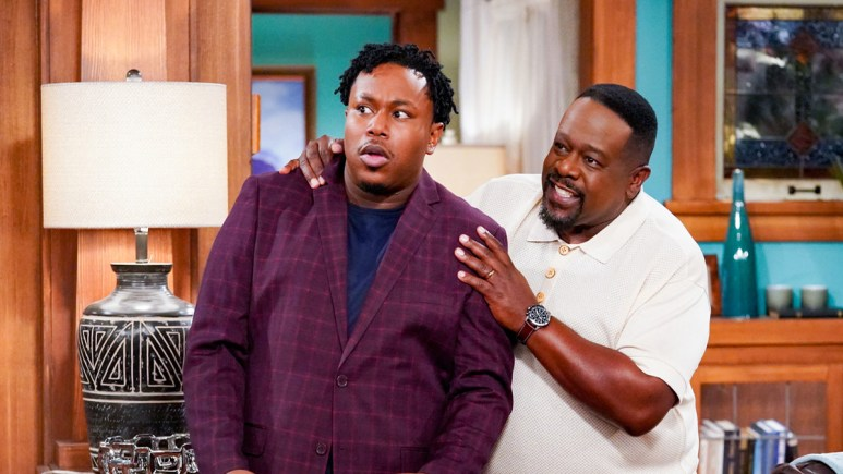 Marcel Spears and Cedric the Entertainer on the set of The Neighborhood