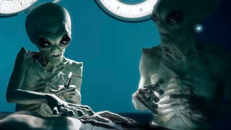 Promotional image for FX's American Horror Story: Double Feature shows aliens experimenting on humans