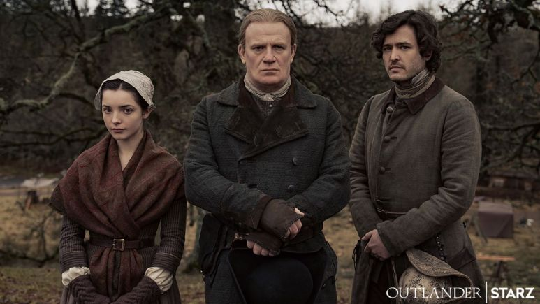 Jessica Reynolds as Malva, Mark Lewis Jones as Tom Christie, and Alexander Vlahos as Allan, as seen in Season 6 of Starz's Outlander