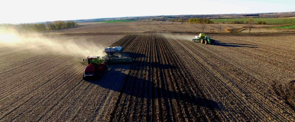 9_Ton_GEN_II_Montag_on_Tracks_behind_16_row_JD_2510S_Strip_Till_bar_and_9_Ton_JD_2510H_with_Dry_Fertilizer_running_side_by_side
