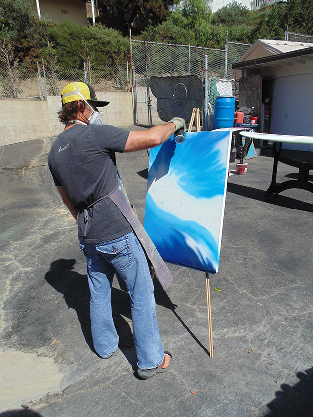 Drew Brophy laying background colors on NELSCOTT Reef painting with Montana Cans  spray paint