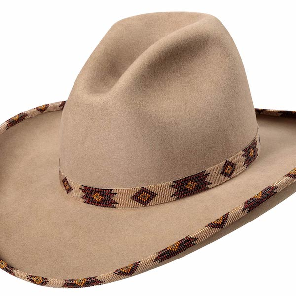 Light Brown Wide Brimmed Low Gus Fur Felt Hat with a Western style crease in the crown. It also has a matching brown beaded hat band and beaded brim.