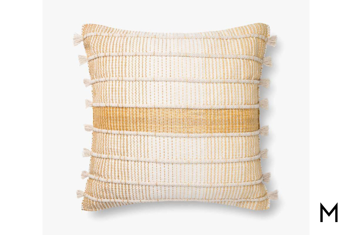 accent pillow in neutral and gold fabric