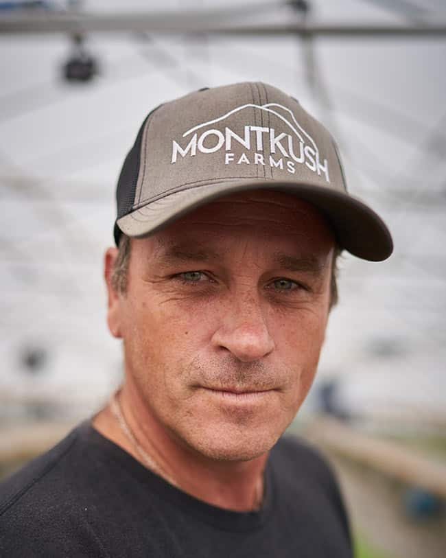 Man wearing MONTKUSH Farms Cap