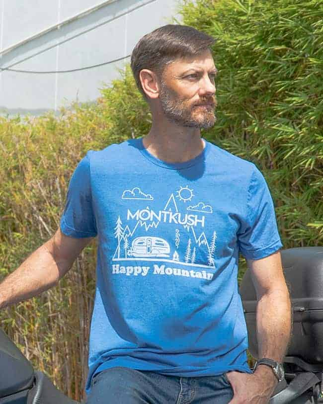 Man wearing Airstream Happy Mountain Unisex Triblend Short Sleeve Tee
